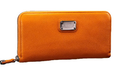 6b840a7ad0 For a price of 445 USD you can get yourself this lovely and bright orange  shade wallet with Tod's name on the plate. It could be a great gift to  someone as ...